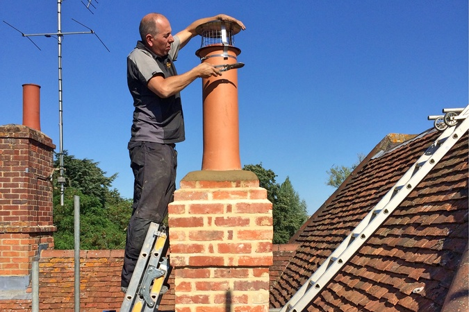 Final touches with a new chimney pot and a mesh bird and rain guard