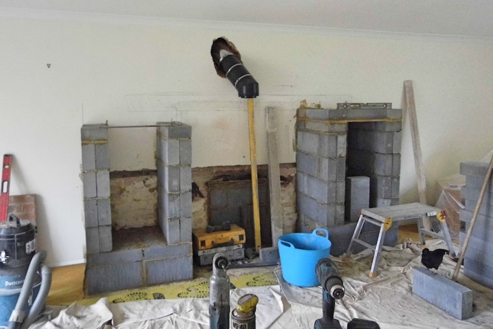 Once we had removed the fireplace we could start to create a new larger fireplace to fill the large wall space.