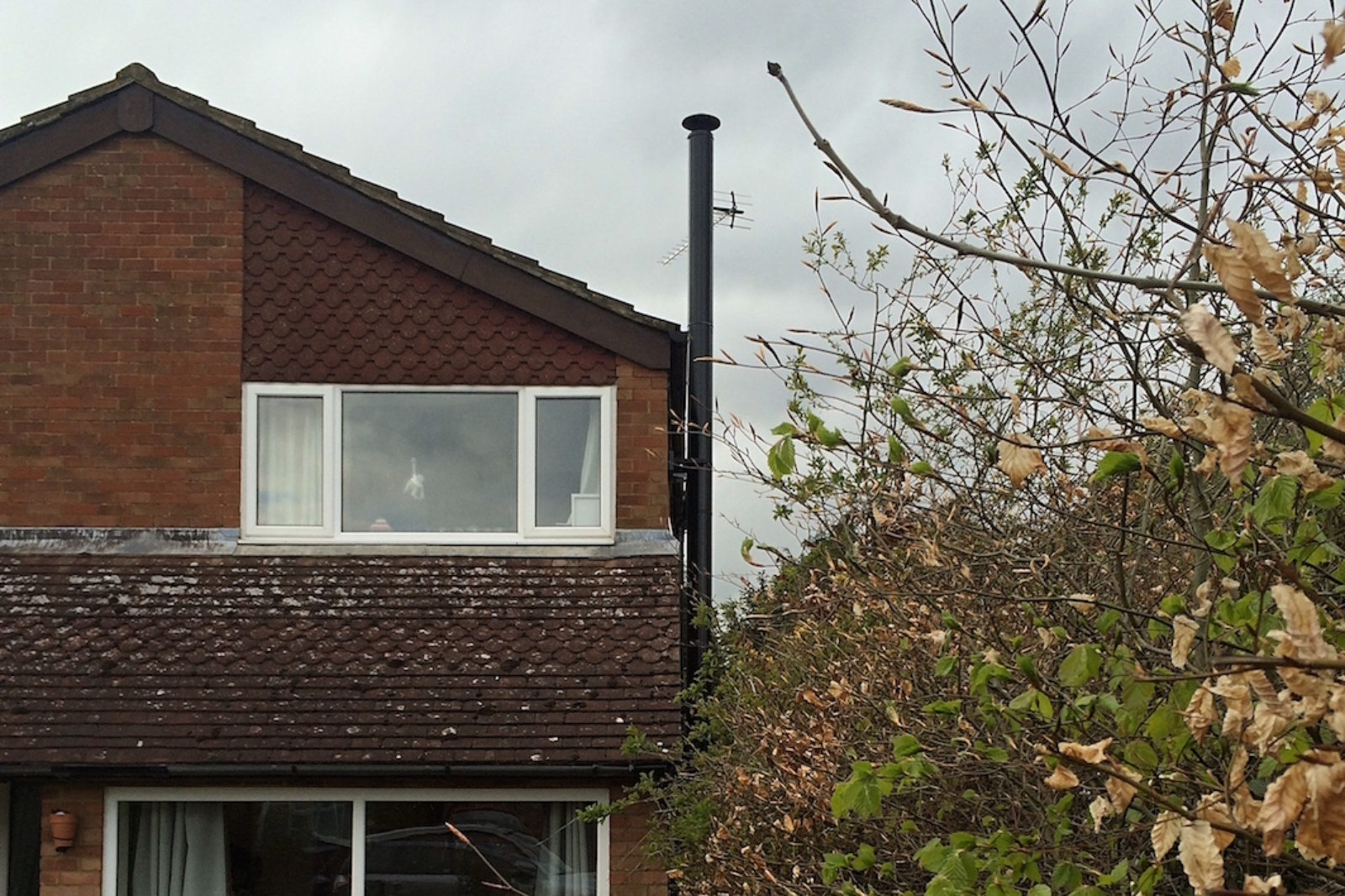 An external twin wall flue to a detached property in Wendover, Buckinghamshire