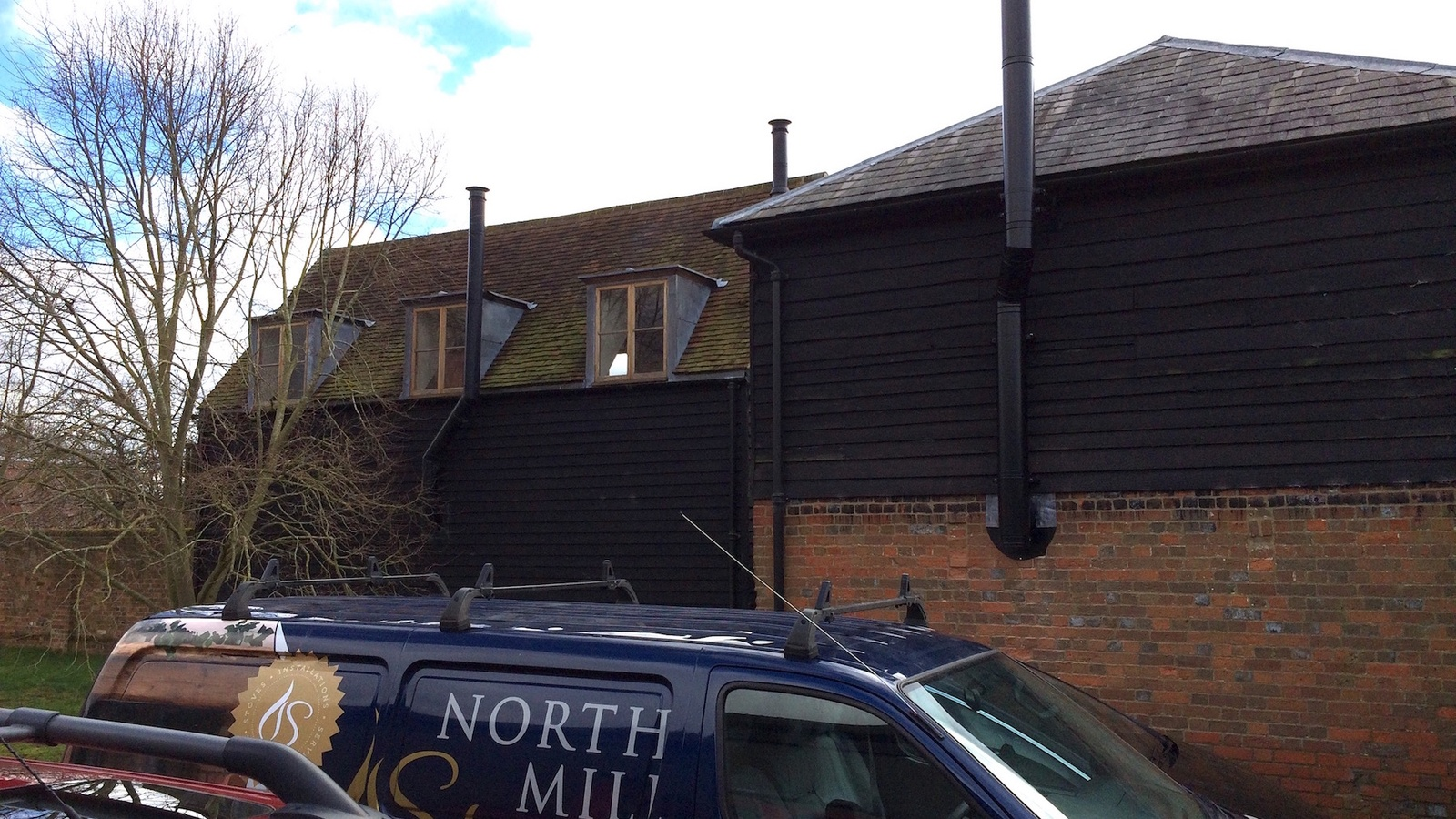 A triple installation of flues in White Waltham serving family apartments and a home office.