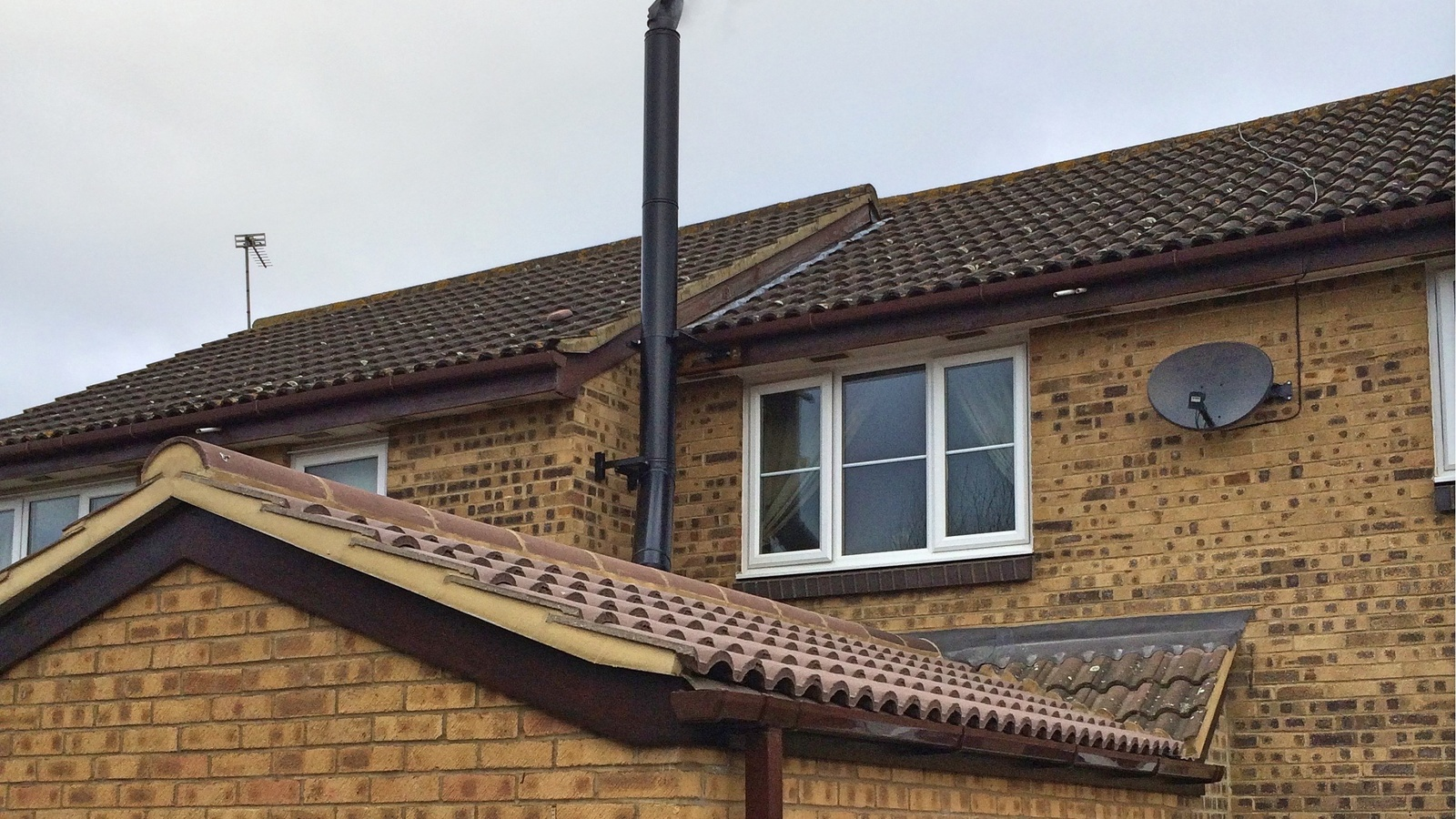 A very neat installation of a twin wall flue to a single storey extension. The neighbours permission was sought for supporting the flue.