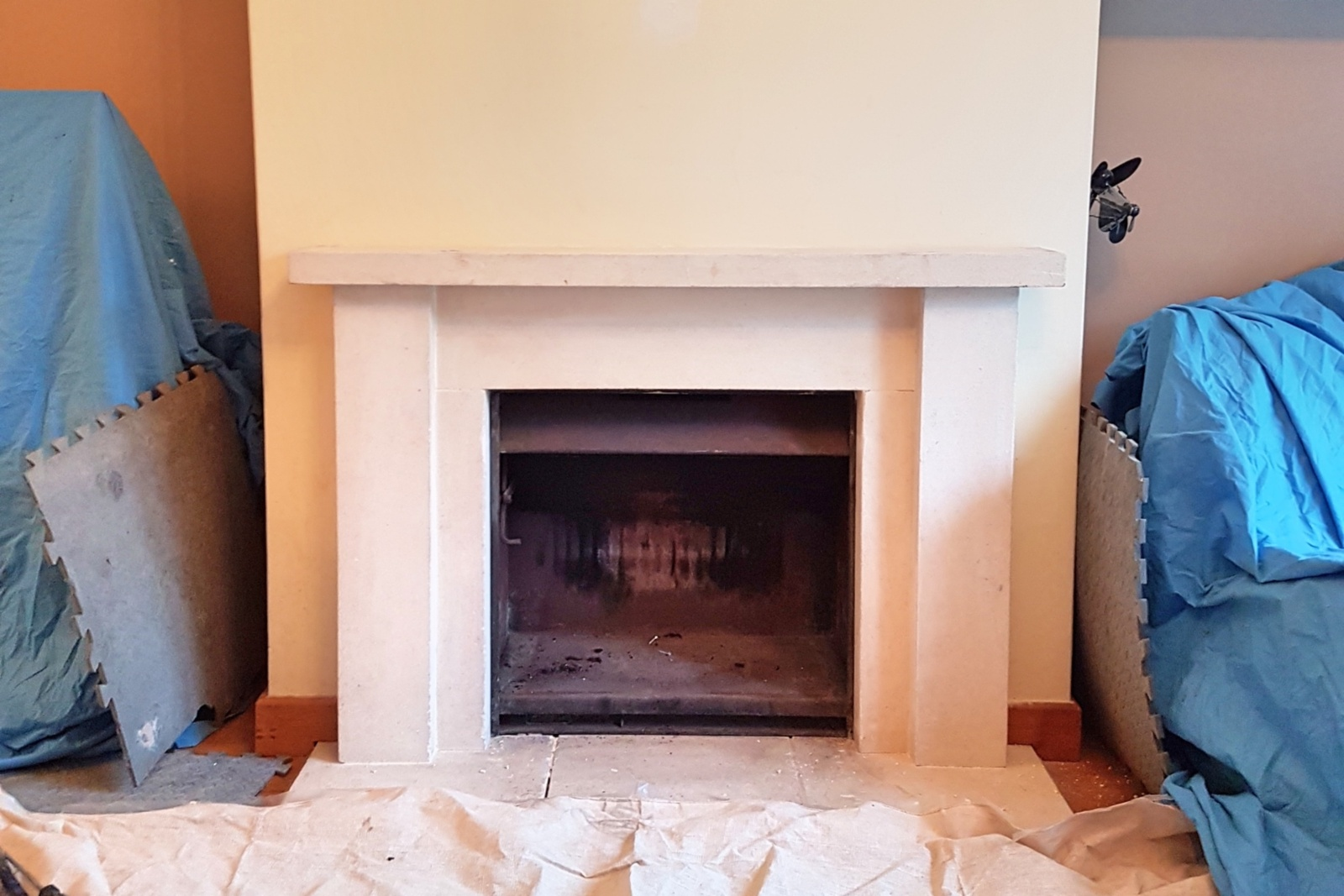 The existing stone fireplace did not suit the modern property