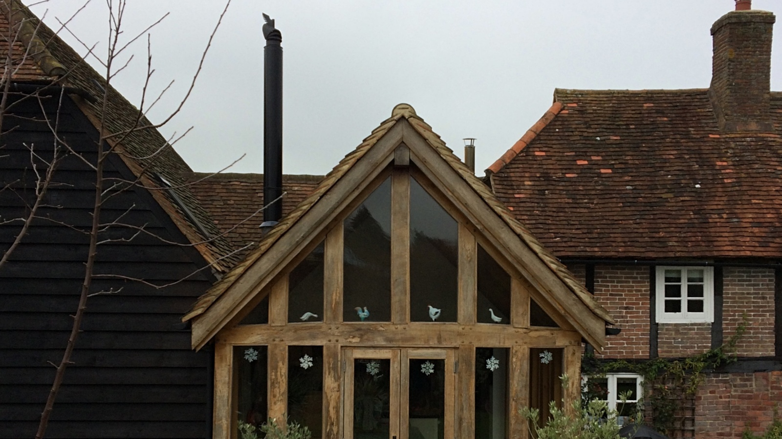 Listed buildings permission was sought for this oak frame barn conversion extension to a family kitchen.