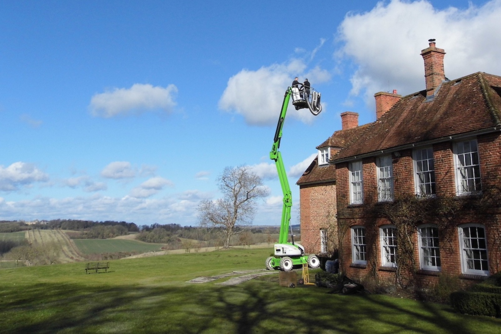 Using a cherry picker and grass boards to protect a lawn at a manor house.