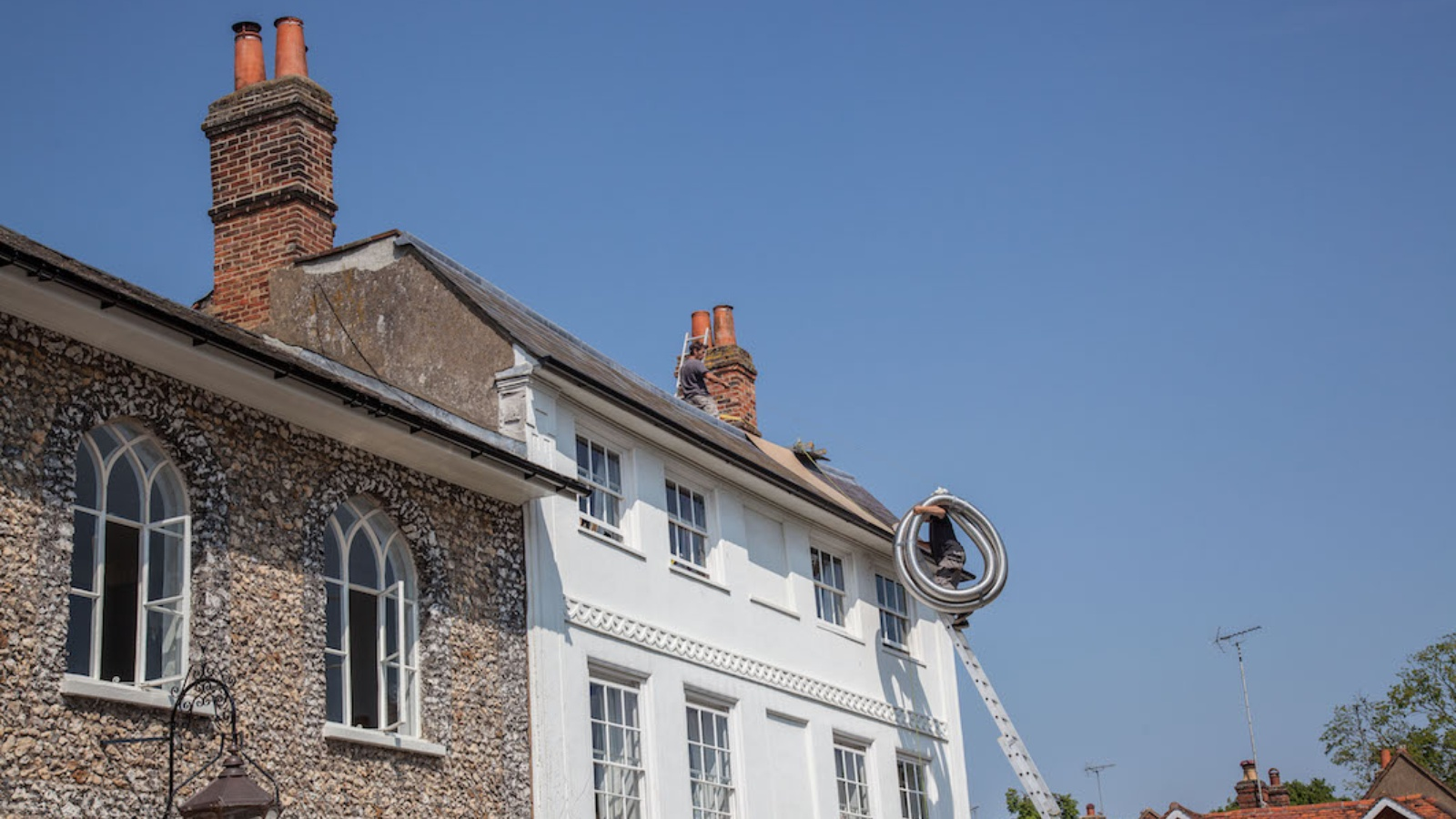 Accessing the roof of a listed property using ladders.