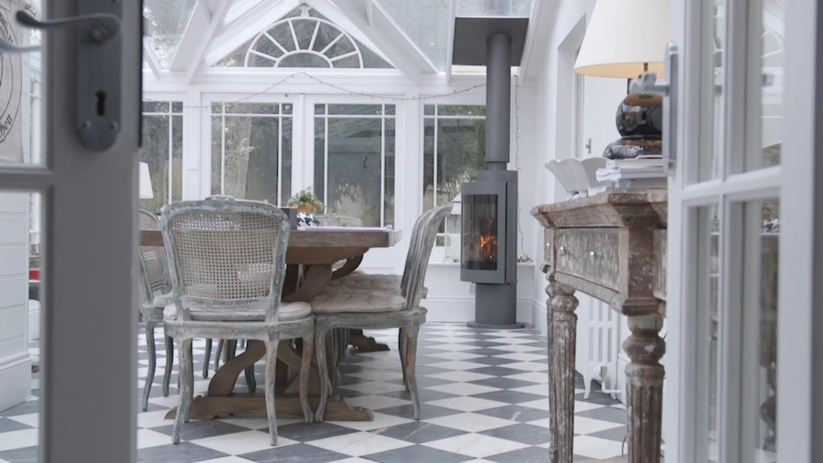 The conservatory dining room with Harrie Leenders slim Cylon log burner.