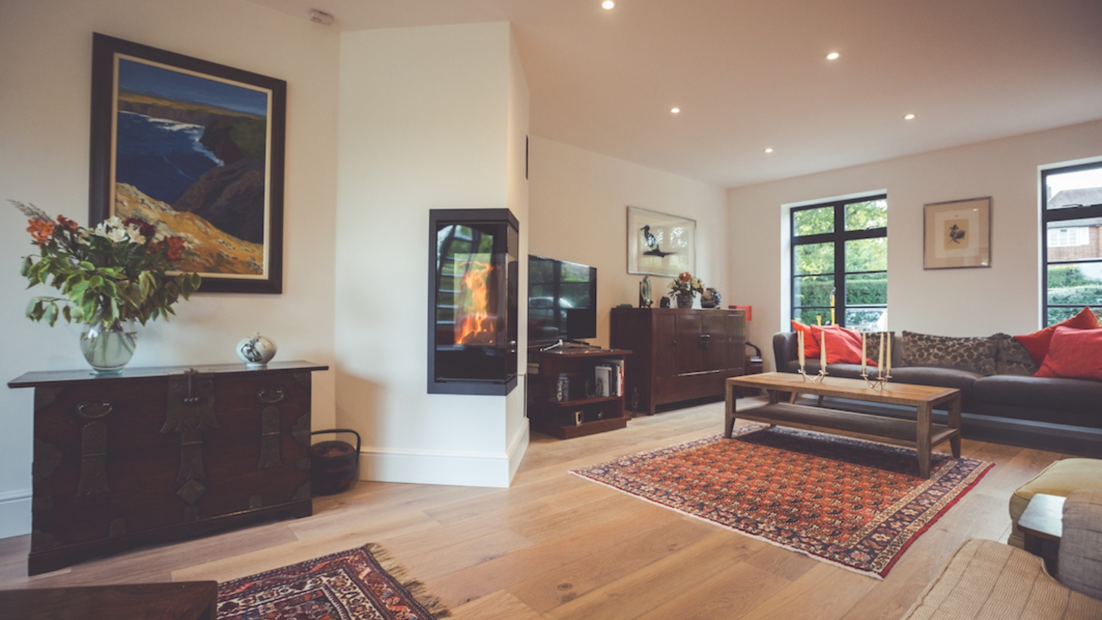 An architect-led design using a peninsular stove layout to breakup a large space