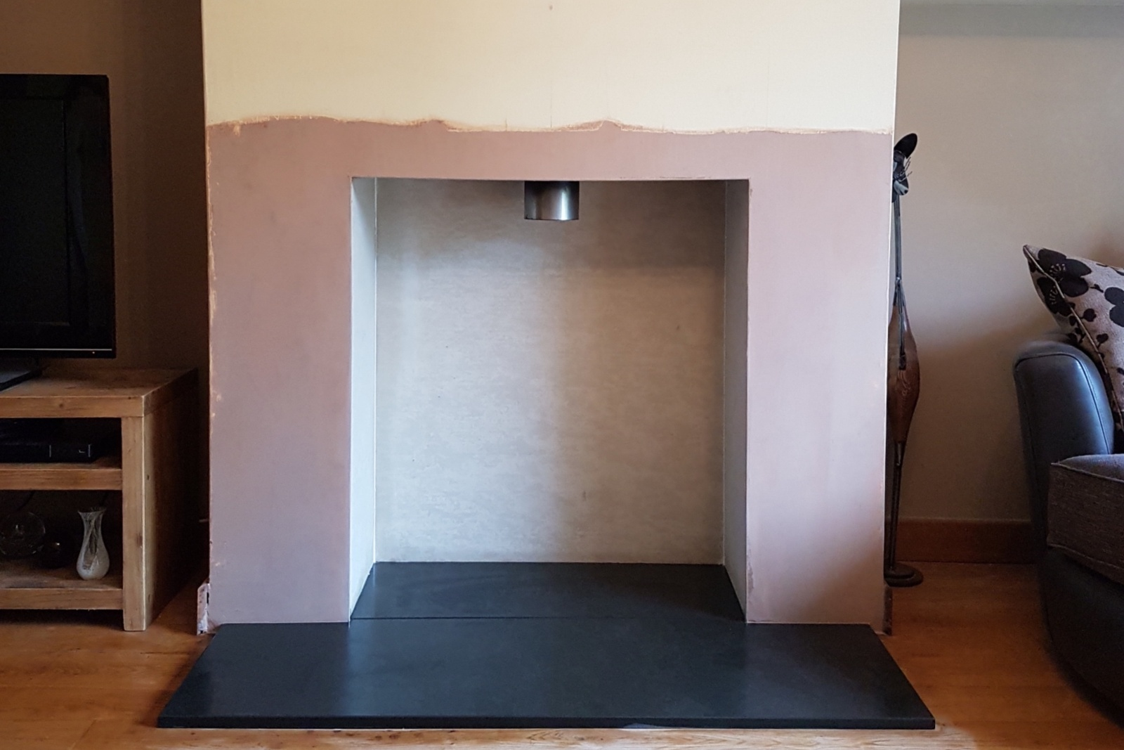 A new natural slate hearth was laid and the chamber lined with heatproof board