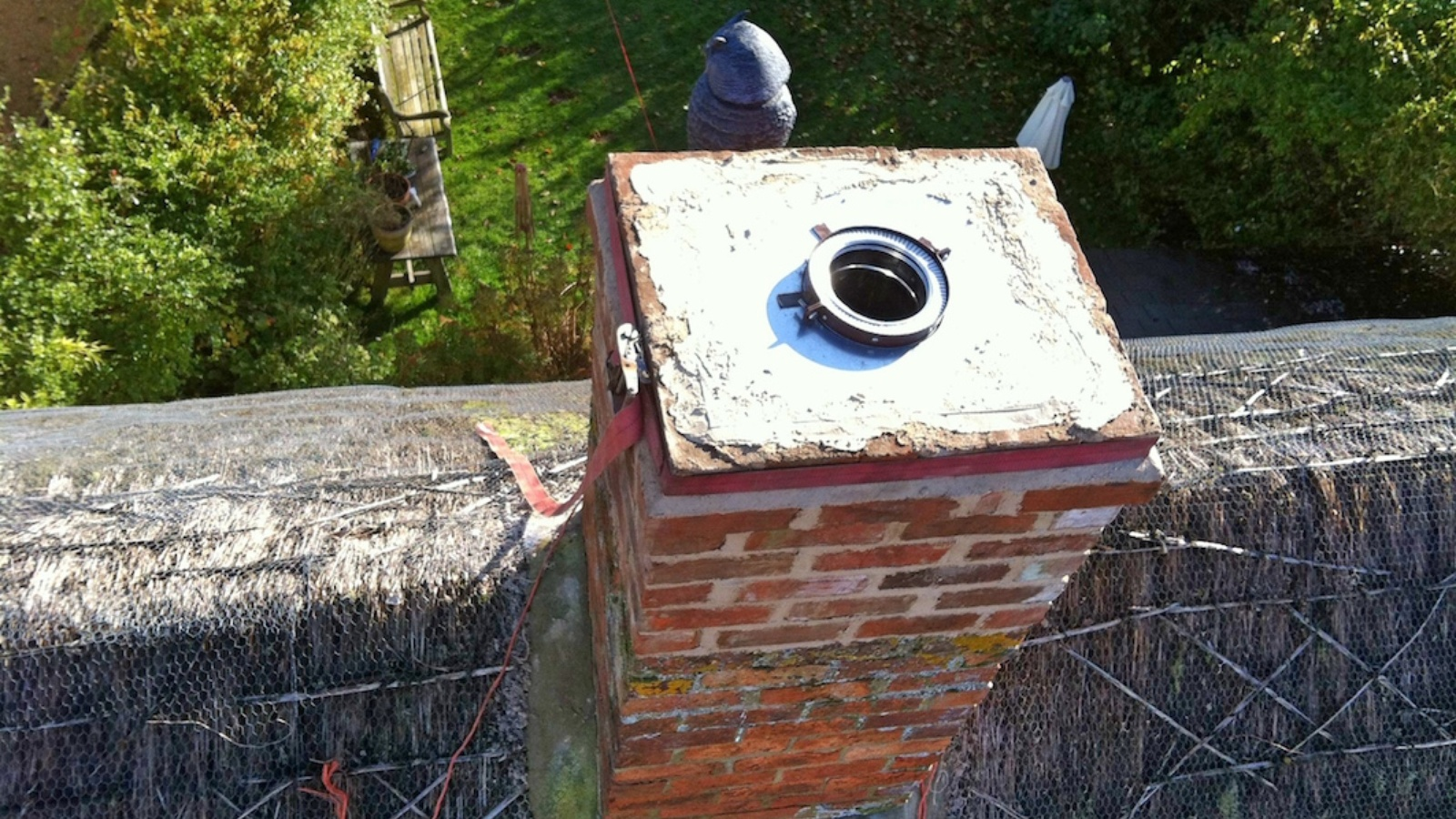 A twin wall flue securely installed to maintain a safe air gap between the chimney stack and the flue.