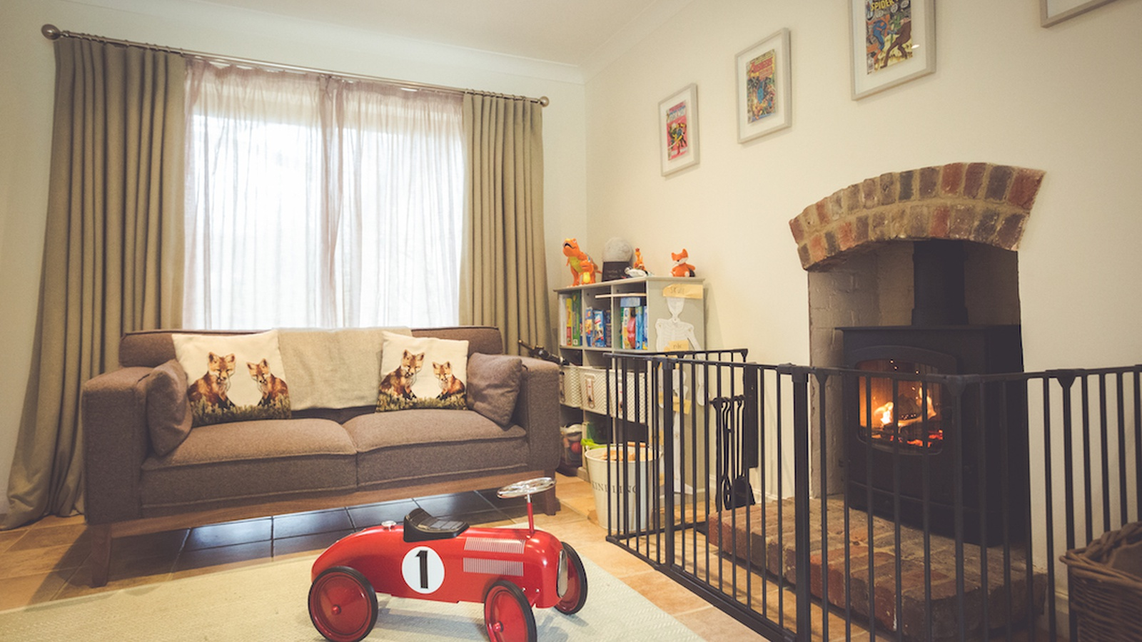 The Charnwood Cove 2 in a playroom with fireguard.