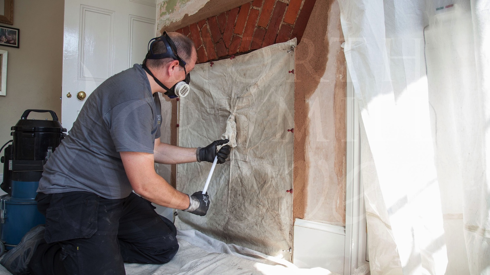 Multi-skilled Engineers carrying out chimney sweeping and stove installations