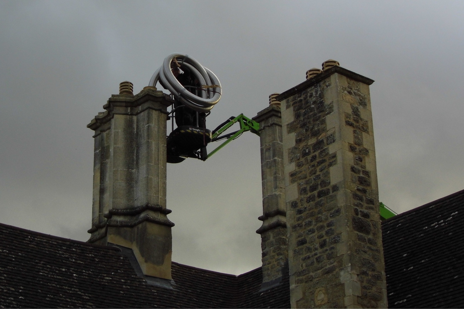 Lining the chimney of a tall listed property - Littlemore, Oxford