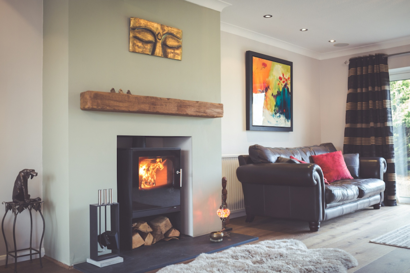 The stunning Rais Q-Tee Two on store stand in a remodelled fireplace. Originally a wooden surround and marble hearth made the room feel dated.