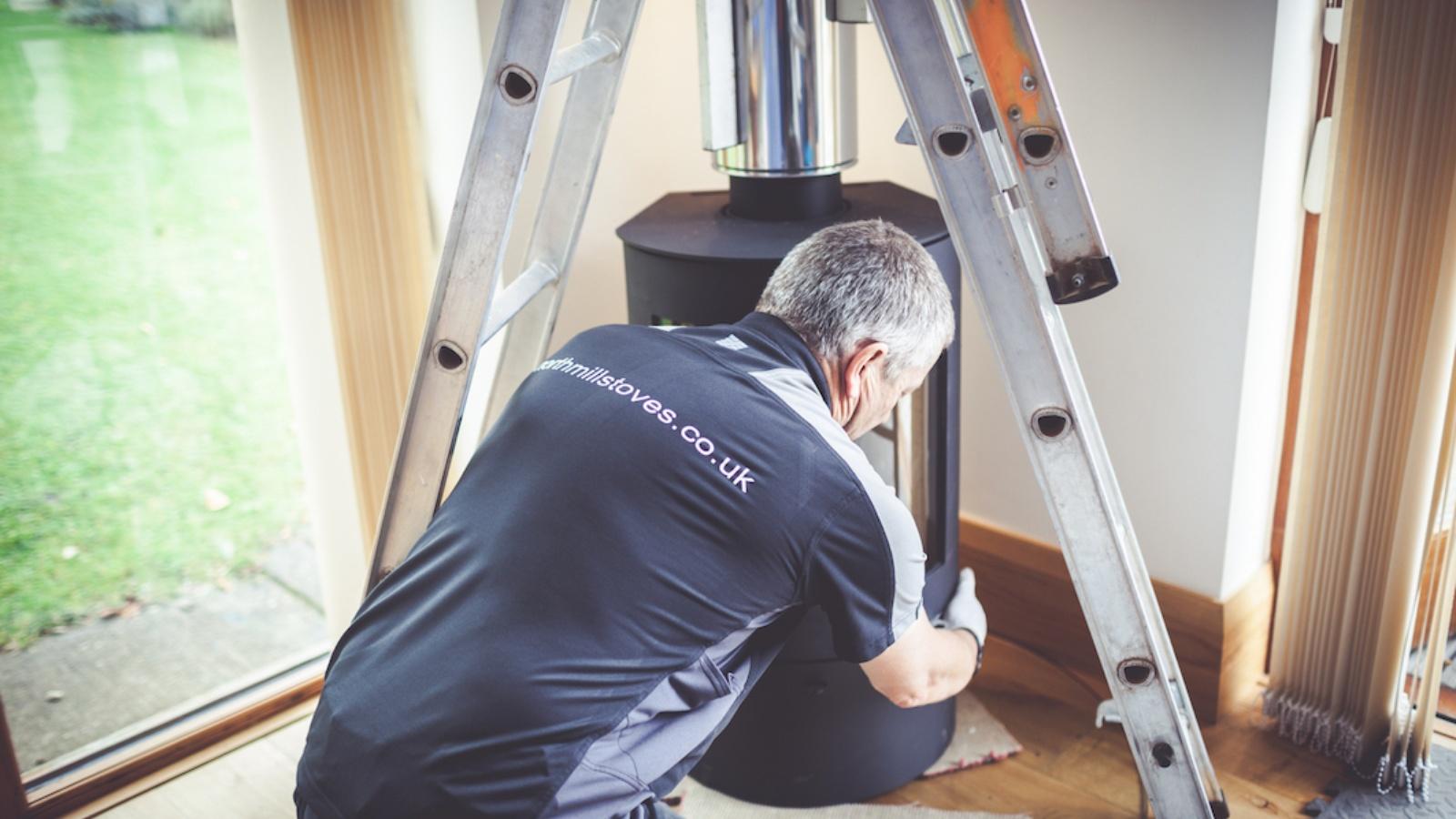 HETAS Engineer Adjusting Stove Position