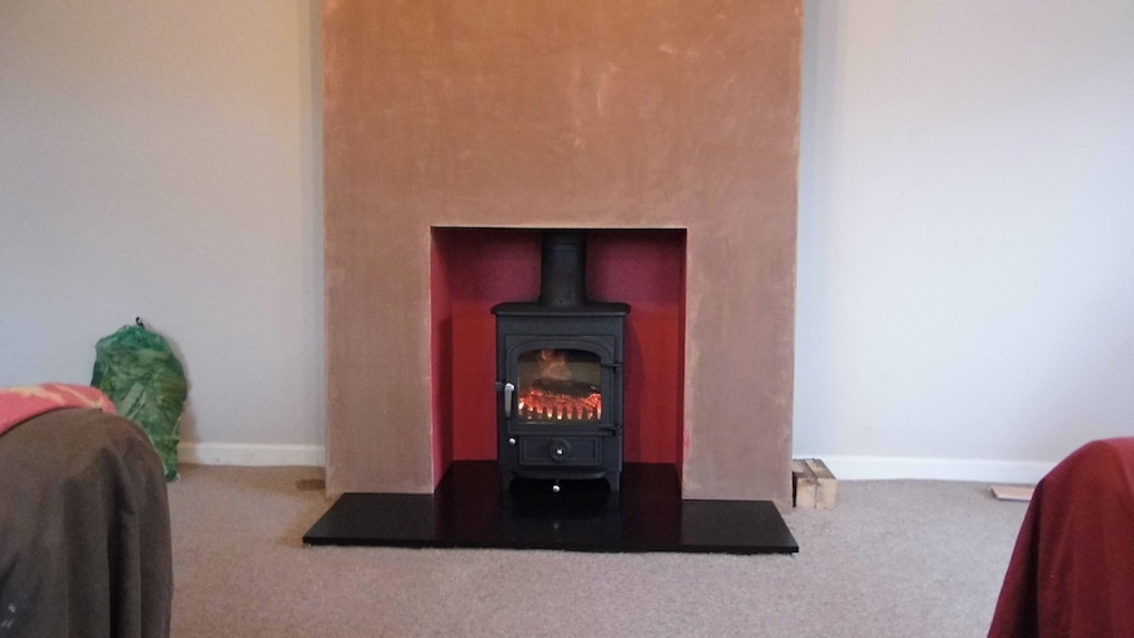 A faux chimney breast complete with Clearview Pioneer 400 in Chinnor. Painted chamber ready for a new stone surround to be fitted.