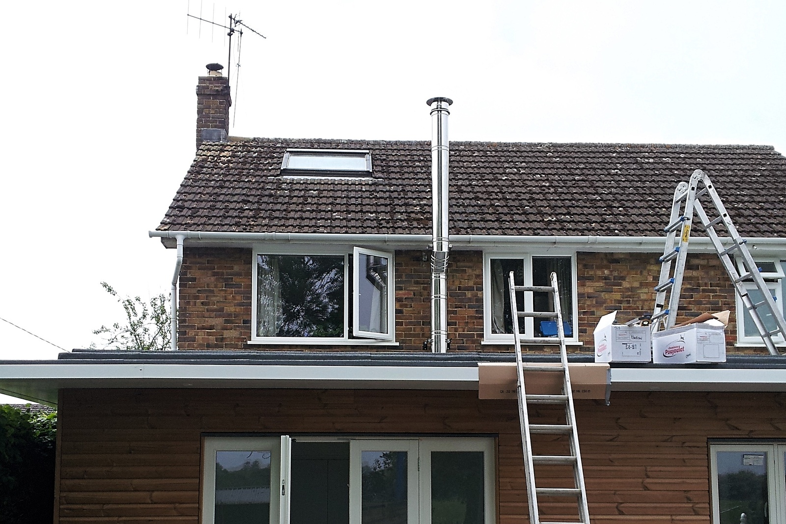 This rear kitchen extension integrates neatly with the main house which supports the twin wall flue.