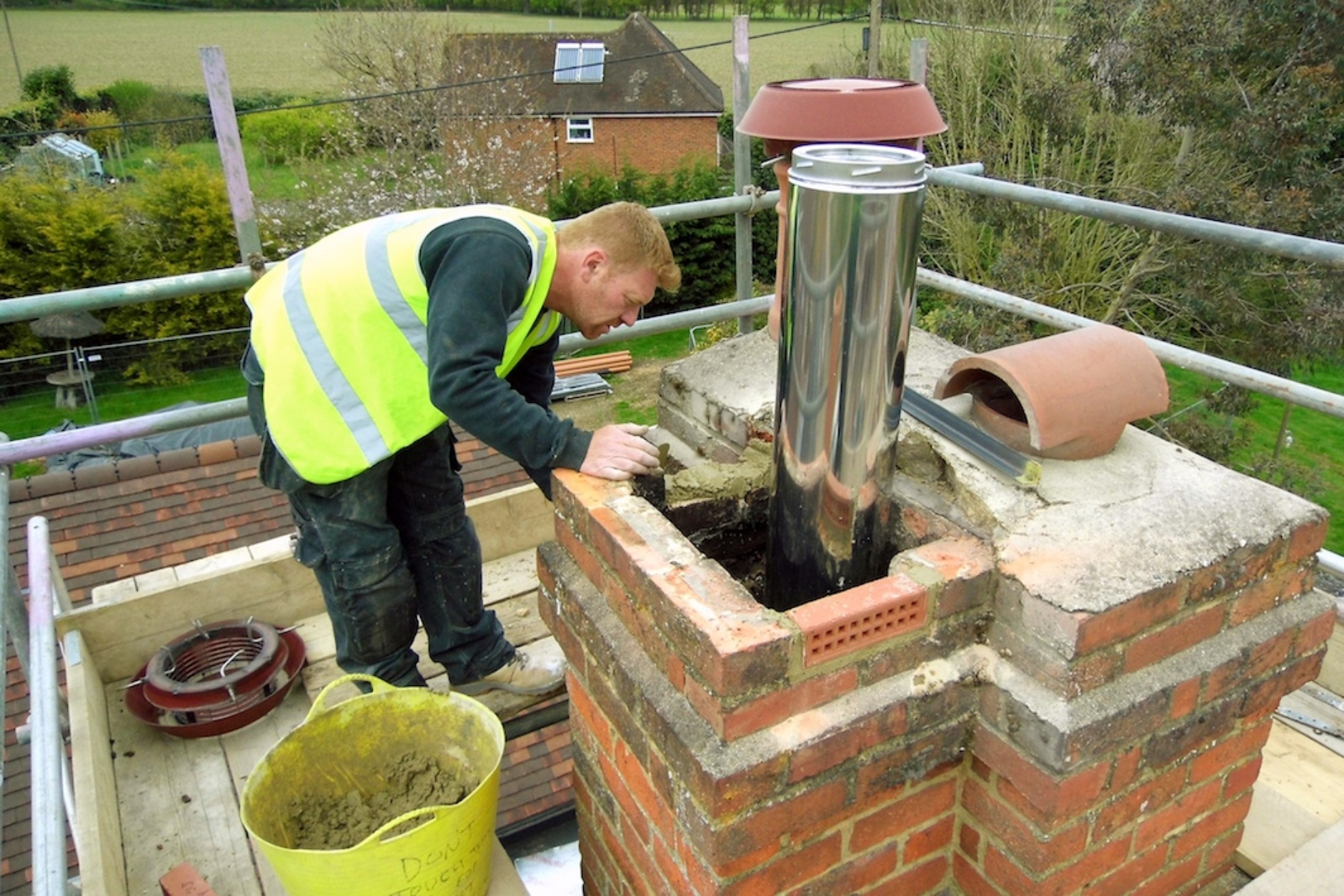 Our HETAS engineer raises the height of the chimney stack in a thatched cottage by adding additional brick courses. This ensures any flying embers cool before they land.