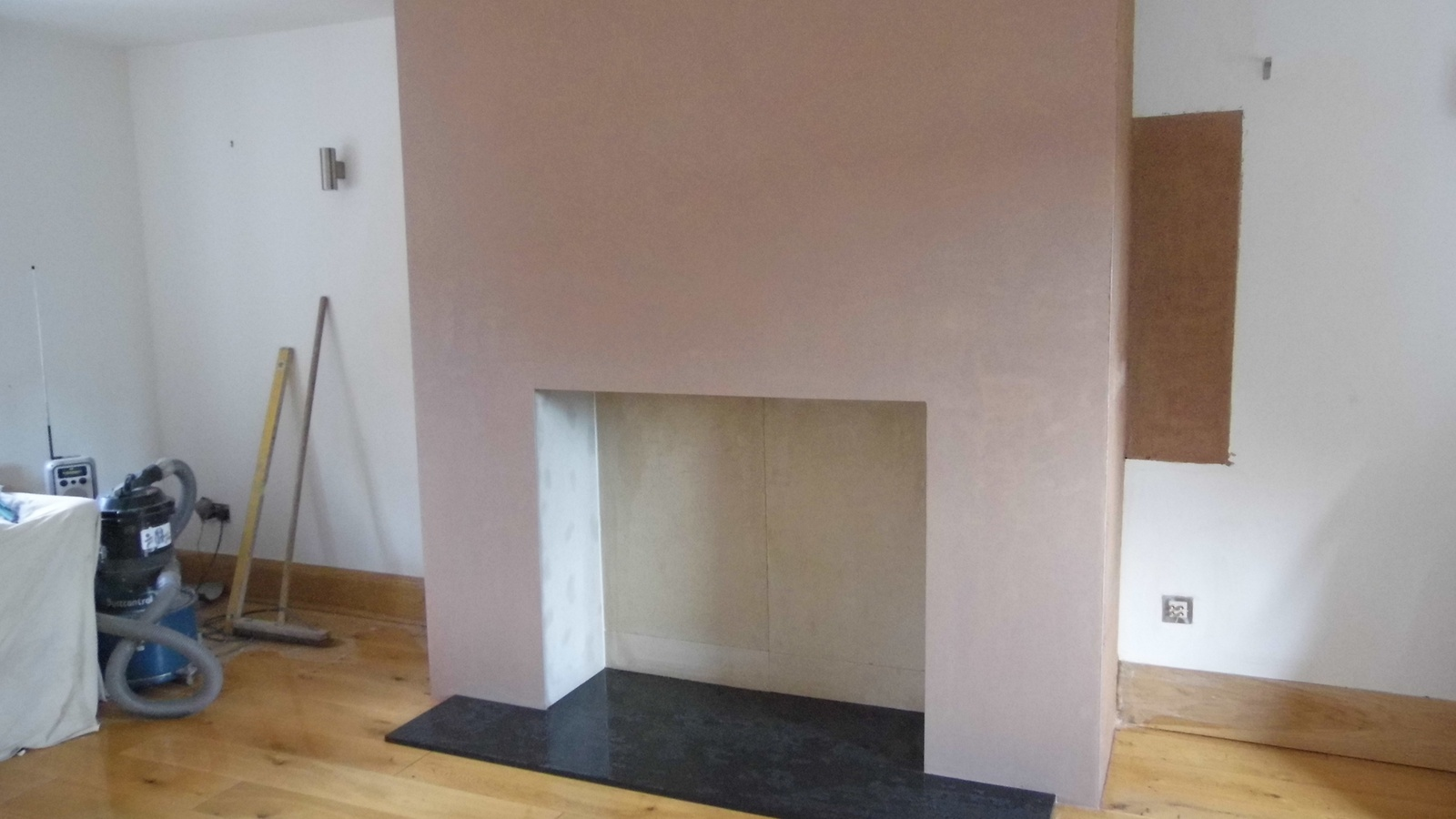 Faux Chimney Breast Plastered with Granite Hearth Laid