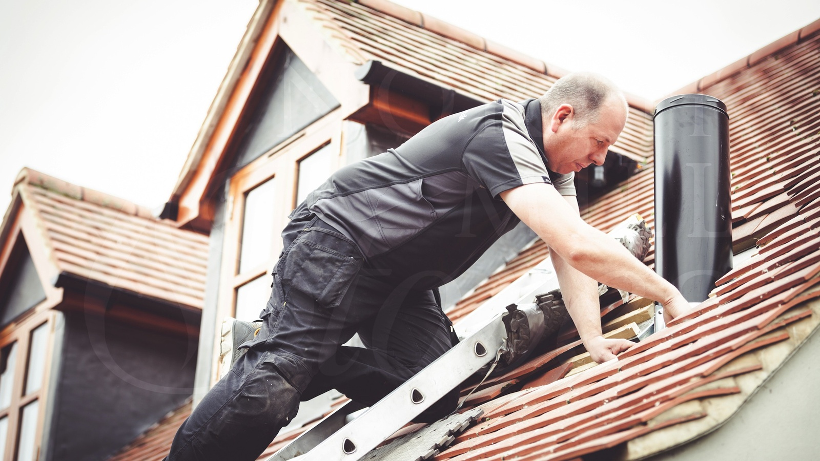 Roof work being carried out during a twin wall flue installation