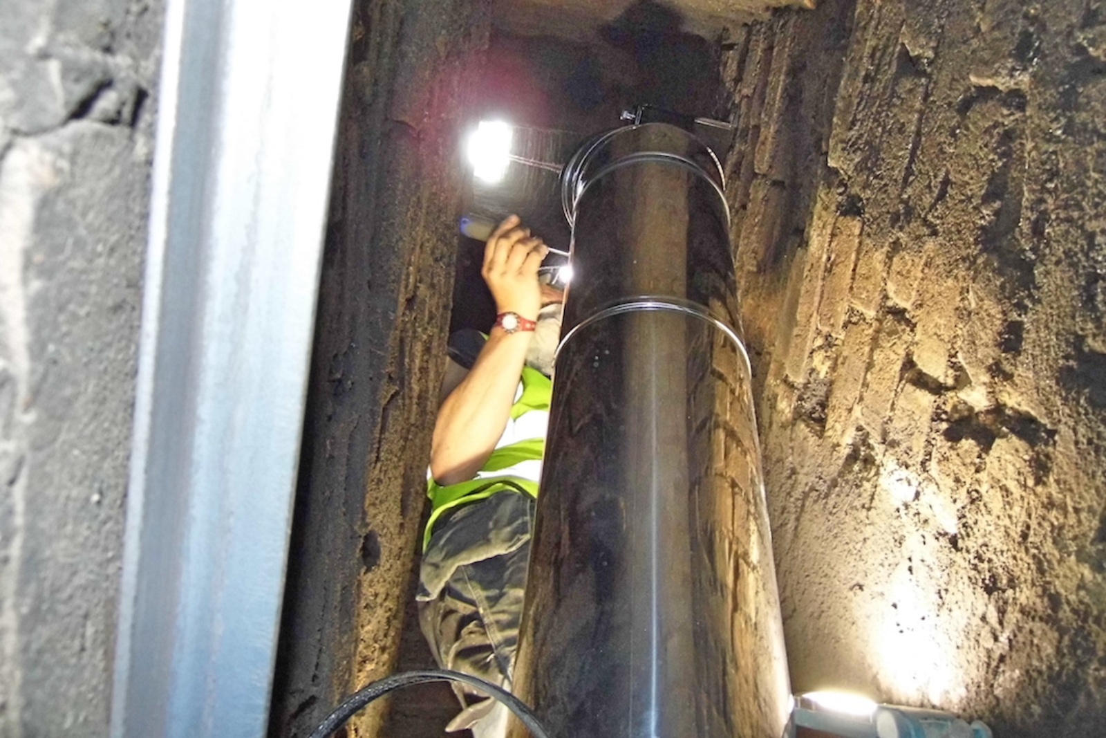To safely support a flue within a chimney stack, the engineers need to physically get up and into the void.
