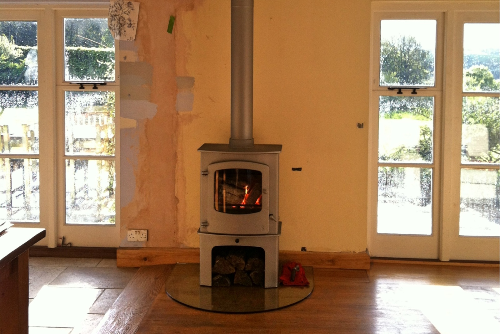 With the stove in situ, the owners could complete the transformation of the room with a fresh coat of paint.