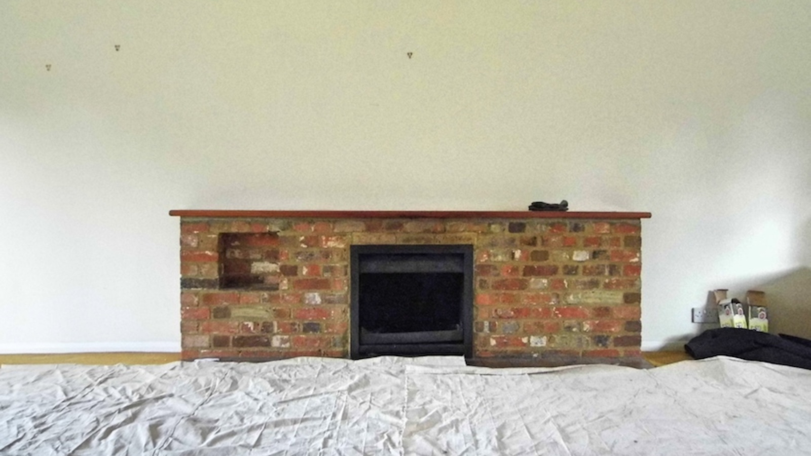 The original fireplace looked lost in the room and was dated.