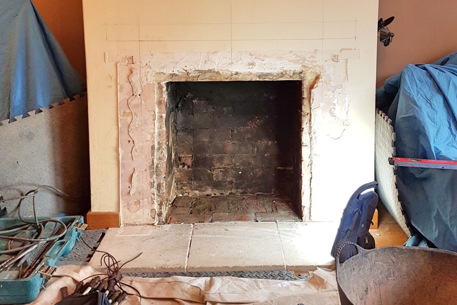 The existing surround was removed and the chamber enlarged