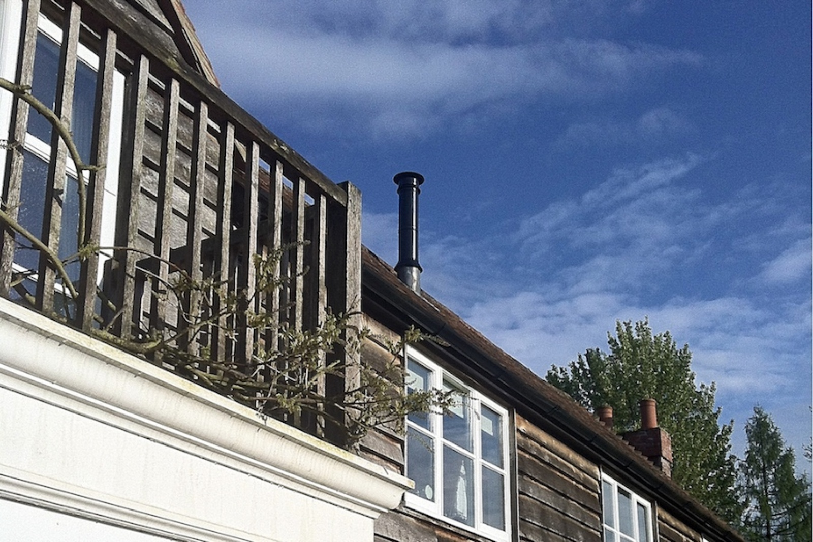 The black twin wall flue was taken up through the roof to provide minimal impact visually from the garden.